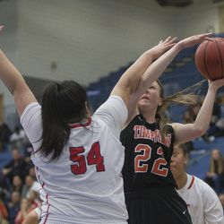 East's Lani Taliauli attempts to block a shot from Timpview's Hannah Glazier during East's 68-48 victory against Timpview in the Class 5A state championship game at Salt Lake Community College in Taylorsville on Saturday, Feb. 24, 2018.