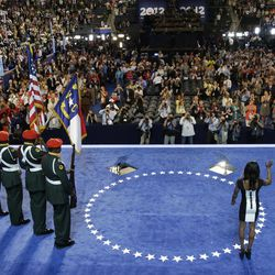 Olympic gold medalist Gabby Douglas waves to candidates after reciting the Pledge of Allegiance at the Democratic National Convention in Charlotte, N.C., on Wednesday, Sept. 5, 2012.