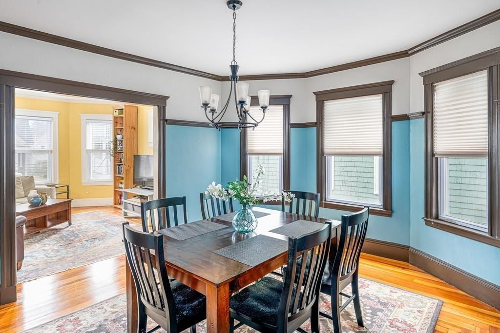 A dining room, also with a bay window, and there's a table and chairs and a large opening to the living room.