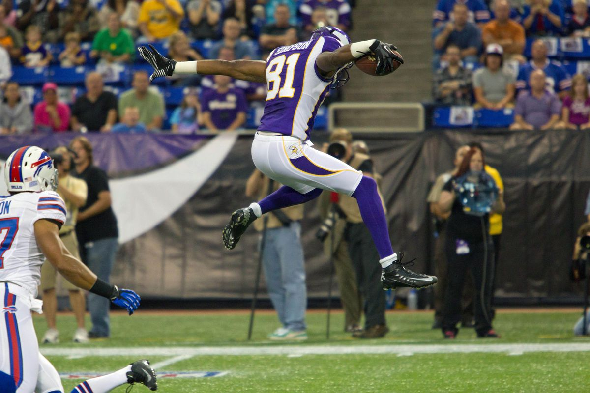 Aug 17, 2012; Minneapolis, MN, USA; Minnesota Vikings receiver Jerome Simpson (81) jumps over Buffalo Bills  cornerback Jairus Byrd (31) for a first down in the first quarter at the Metrodome. Mandatory Credit: Brad Rempel-US PRESSWIRE
