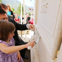 Disney Lee, 5, places mortar in the cornerstone at the Payson Utah Temple cornerstone ceremony in Payson  Sunday, June 7, 2015.