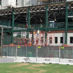 Scaffolding going up, along the outside western wall of the ballpark