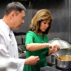 Linda gets some expert cooking advice from Arun.| Victor Hilitski/For the Sun-Times