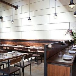 Chef Thomas McNaughton strolls by six counter-height seats, offering a view of the entire restaurant.
