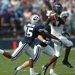 BYU's Justin Robinson, left, breaks up a pass to Cory Rodgers in one of the few plays that didn't go the TCU player's way. He scored four TDs.