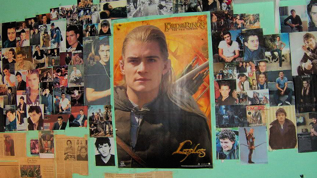 Photo of a bedroom wall featuring images and press clippings of Legolas from The Lord of the Rings movie.