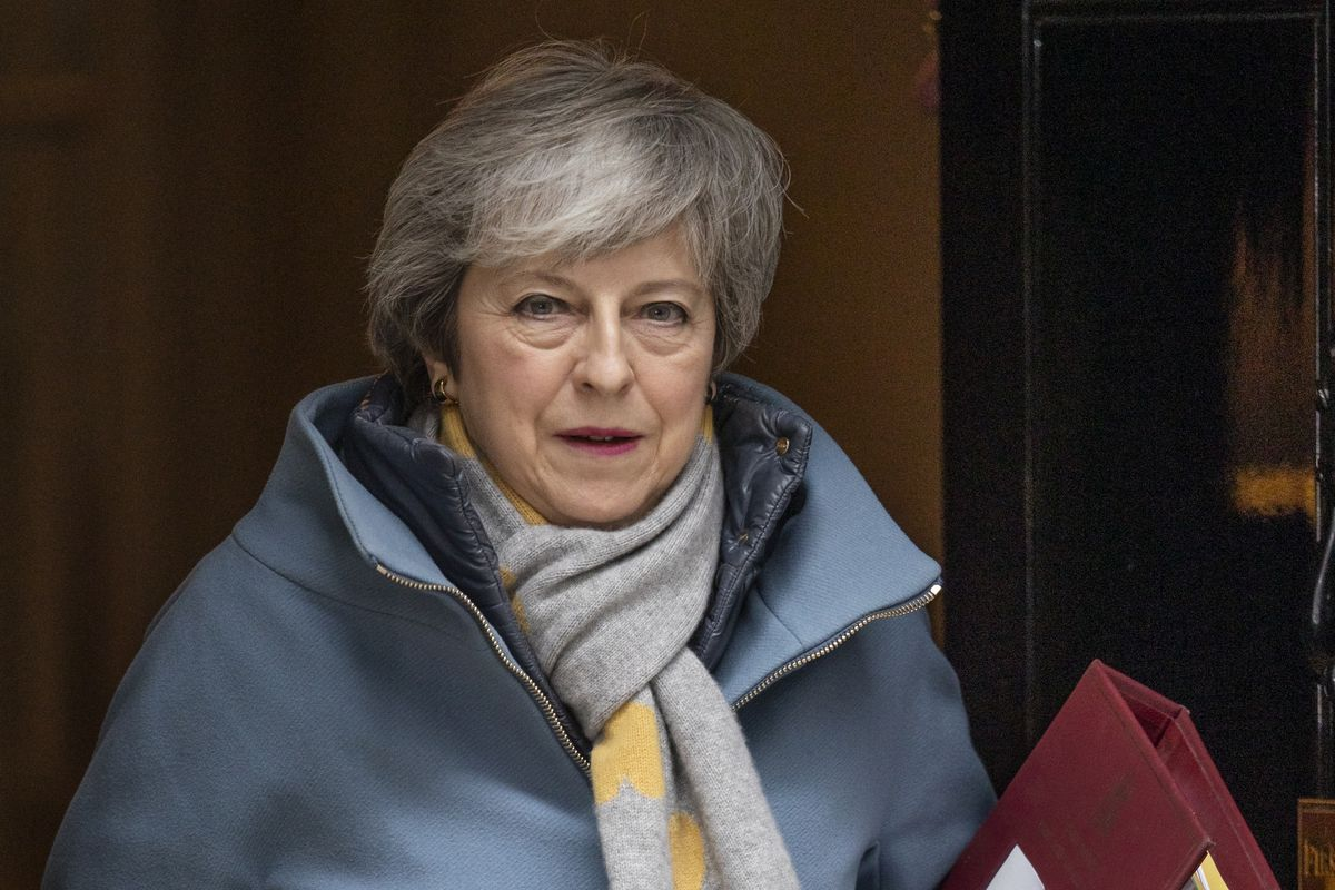 Prime Minister Theresa May leaves 10 Downing Street to attend PMQ's