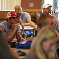 Participants listen as Dustin Smith speaks at the Quarterback Elite camp at Lone Peak Park in Sandy on Friday, July 1, 2016.