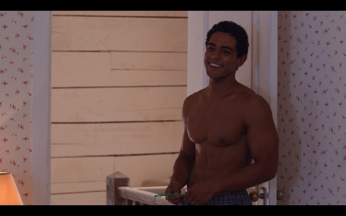 Kevin standing shirtless, smiling