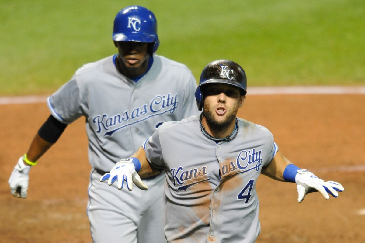 Alex Gordon tries to shimmy and shake the Racists away to no avail.