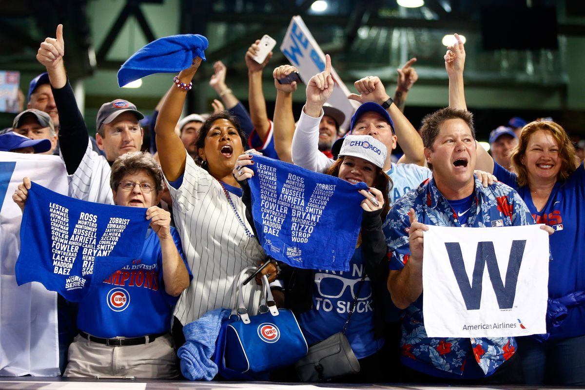 Cubs fans hold towels and flags with the letter W, a symbol that refers to the flag flown atop Wrigley Field when the Cubs win a game.