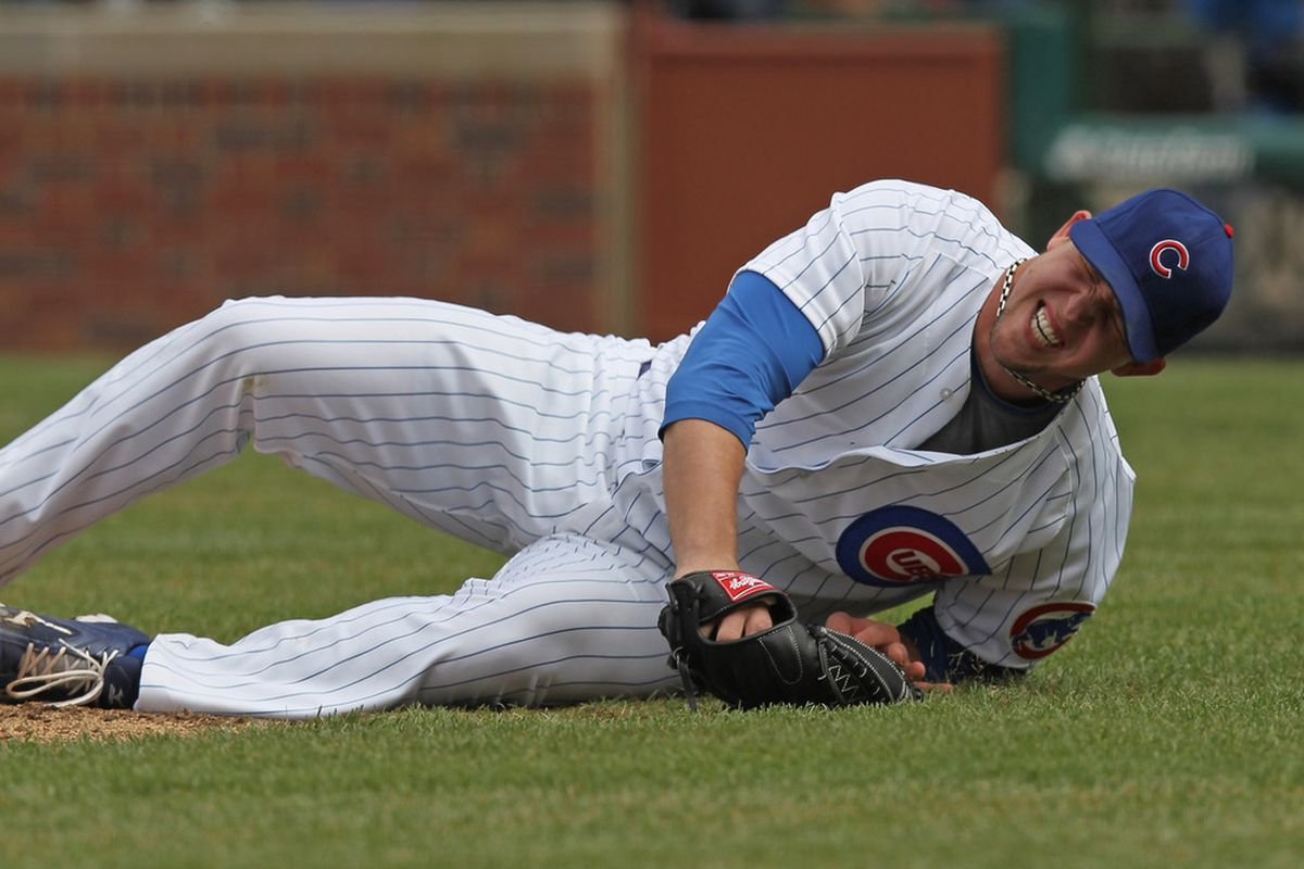 Starting pitcher Paul Maholm of the Chicago Cubs reacts after being hit in the leg on a ball by Dee Gordon of the Los Angeles Dodgers at Wrigley Field on in Chicago, Illinois.  (Photo by Jonathan Daniel/Getty Images)