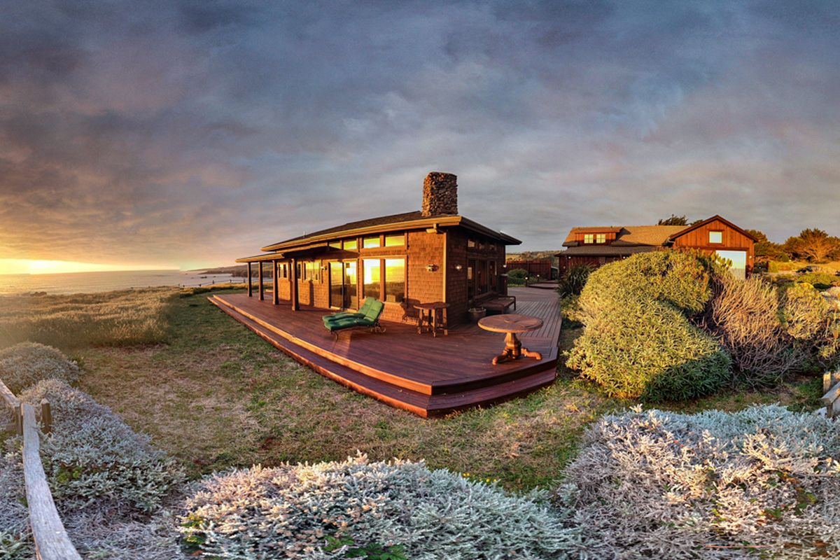 Exterior of seaside home at sunset