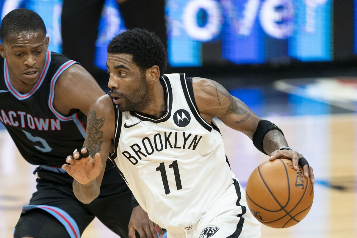 Brooklyn Nets guard Kyrie Irving (11) dribbles the basketball against Sacramento Kings guard De'Aaron Fox (5) during the first quarter at Golden 1 Center.