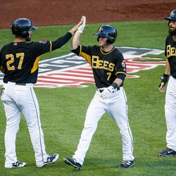 Salt Lake Bees shortstop Matt Williams (7) celebrates a home run with catcher Tony Sanchez (27) during a game against the Las Vegas 51s at Smith's Ballpark in Salt Lake City on Monday, June 5, 2017.