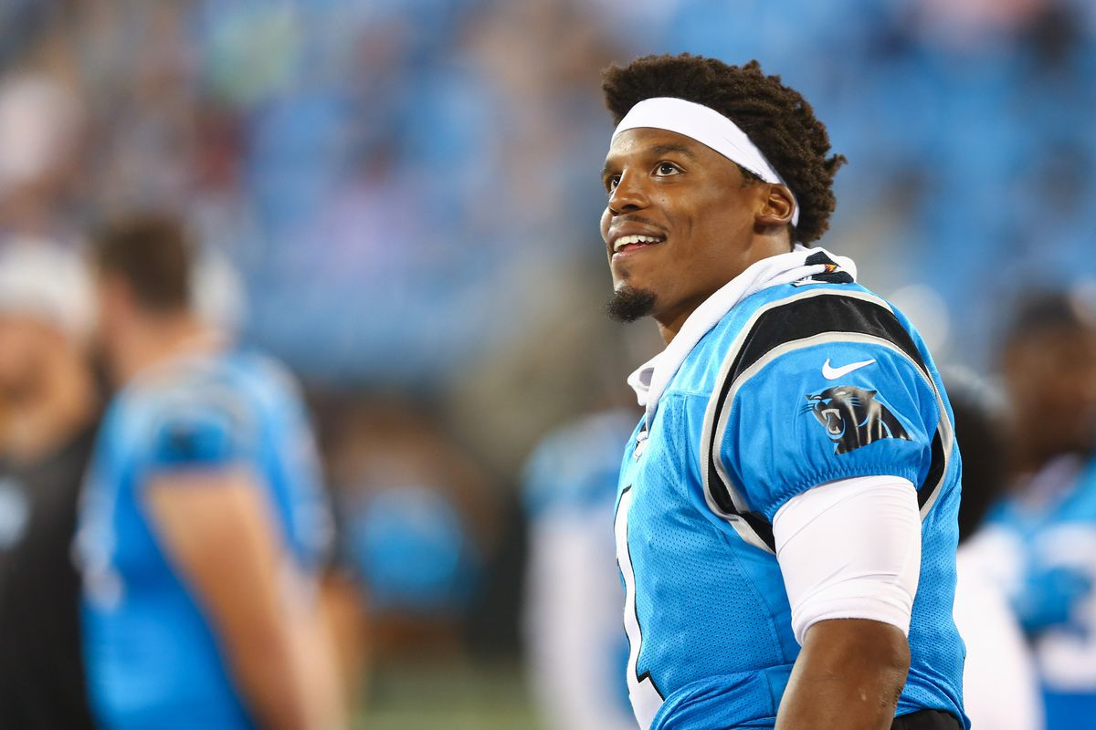 Carolina Panthers quarterback Cam Newton stands on the sidelines in the fourth quarter against the Miami Dolphins at Bank of America Stadium.