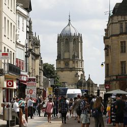 Tourists walk the streets at Oxford, England, on June 14, 2017.