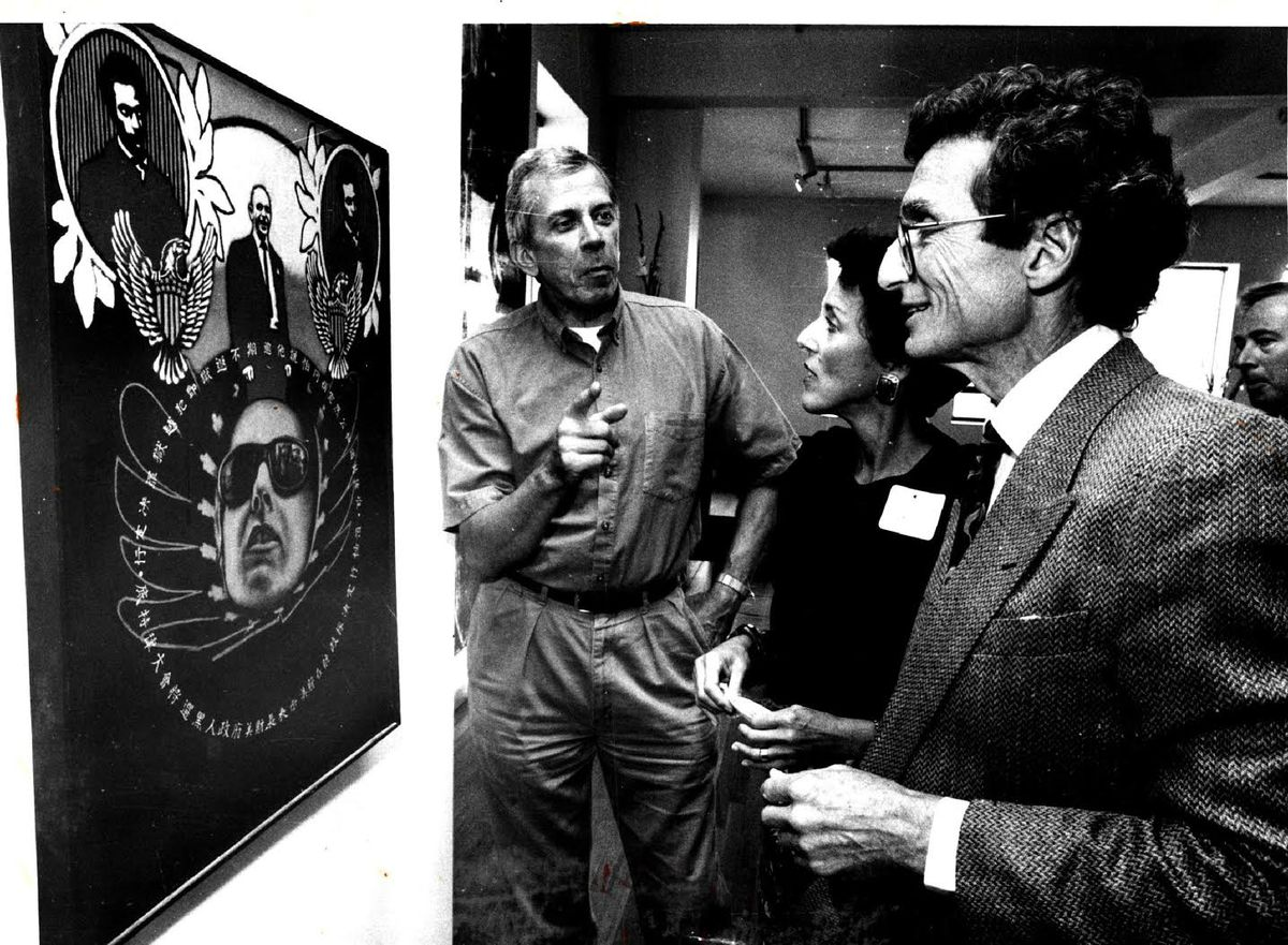 Artist Ed Paschke (left) discussed his painting 'Memorial' with Susan and Lewis Manilow at a reception to announce a fall benefit for the School of the Art Institute of Chicago. | Sun-Times files
