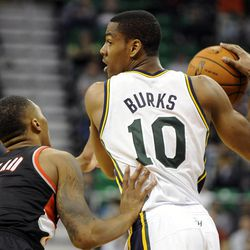 Utah Jazz point guard Alec Burks (10) looks for an outlet as Portland Trail Blazers point guard Damian Lillard (0) defends in the second half of a game at the Energy Solutions Arena on Wednesday, October 16, 2013.