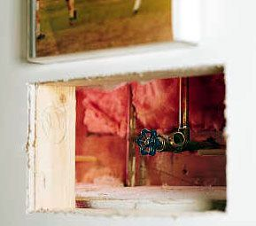 <p>Builders get creative when it comes to hiding mechanical necessities like plumbing shutoffs and electrical panels. A valve is normally hidden behind a removable panel painted the same color as the wall.</p>