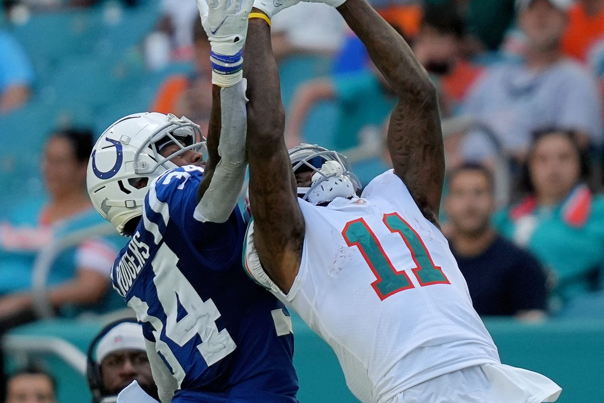Miami Dolphins wide receiver DeVante Parker (11) makes a catch while defended by Indianapolis Colts cornerback Isaiah Rodgers (34) during the second half at Hard Rock Stadium.