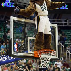 The Bear throws basketballs to the crowd as the Utah Jazz scrimmage in Salt Lake City, Saturday, Oct. 5, 2013.