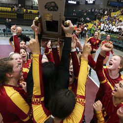 Mountain View hoists the state championship trophy following their win over Farmington in the 5A high school state finals match at the UCCU Center on the Utah Valley University campus in Orem on Saturday, Nov. 9, 2019.