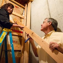Carol and Ed Diener place a cross member for the shelf they are building in their basement in Salt Lake City, Utah, on Monday, Aug. 28, 2017. Ed, a research psychologist, and Carol, a clinical psychologist, have applied principles of happiness and well-being to their family life and their lives together.