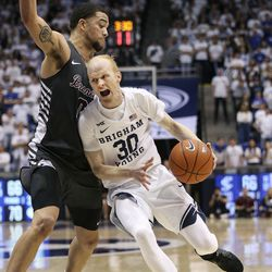 Brigham Young Cougars guard TJ Haws (30) drives into Santa Clara Broncos forward DJ Mitchell (0) at Brigham Young University in Provo on Thursday, Feb. 20, 2020.