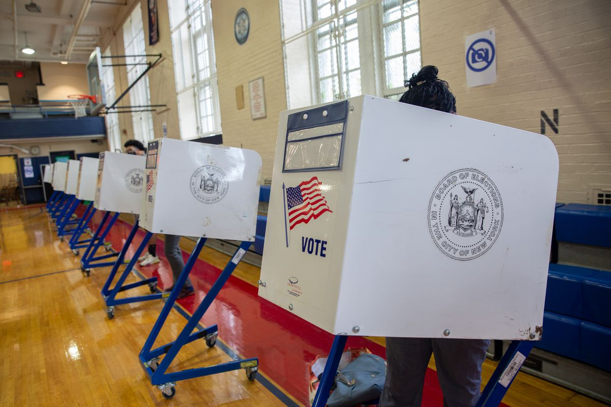 People take part in early voting at the Erasmus Educational Complex in Brooklyn, June 14, 2021.