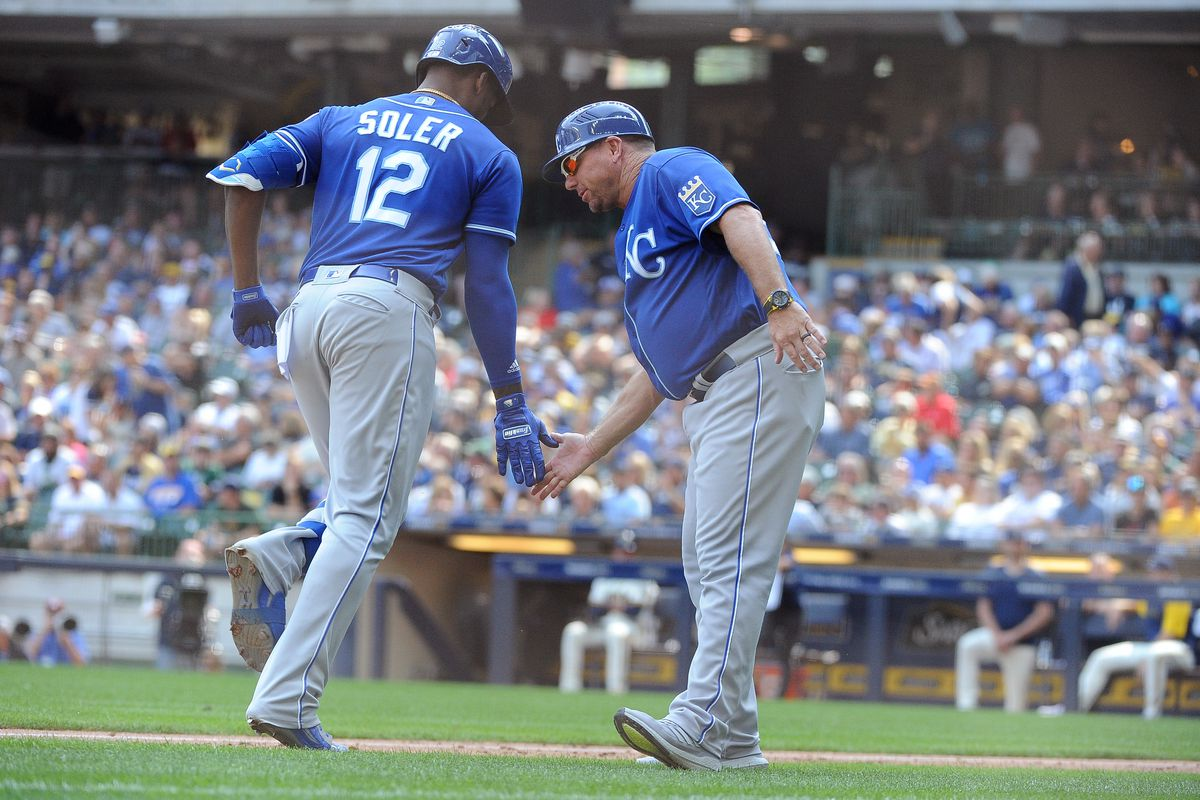 Kansas City Royals right fielder Jorge Soler (12) is congratulated by third base coach Vance Wilson (right) after hitting a home run against the Milwaukee Brewers in the eighth at American Family Field.