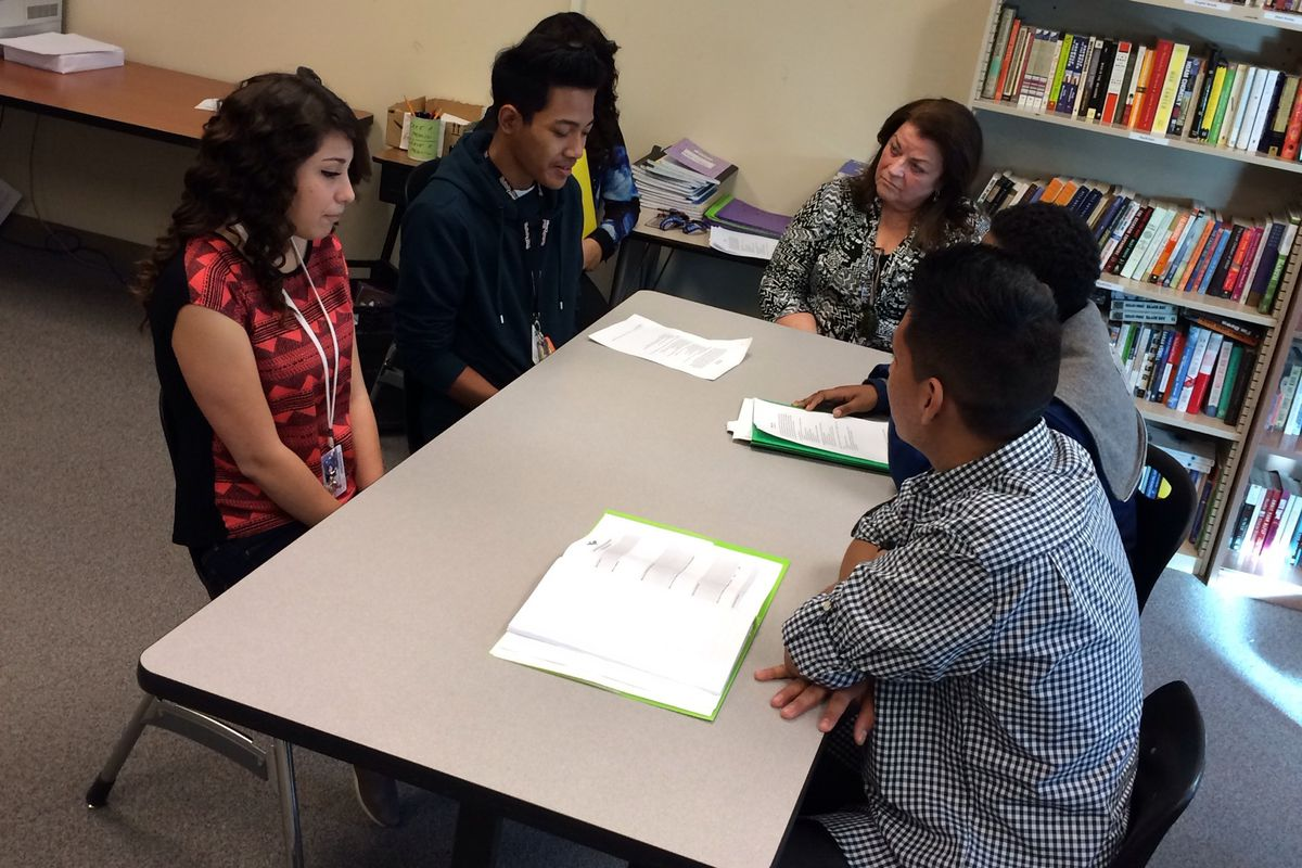 High school students role play a restorative justice seminar with their counselor in this Chalkbeat file photo.
