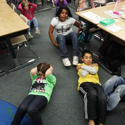 Abbey Neilson, front left, Daniel Berroteran, front right, and Hannah Costley, back center, exercise in Nicole Carter's class at Tolman Elementary School in Bountiful, Monday, Nov. 26, 2012.