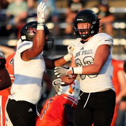 Lone Peak and Timpview play in a high school football game in Provo on Friday, Aug. 14, 2020.