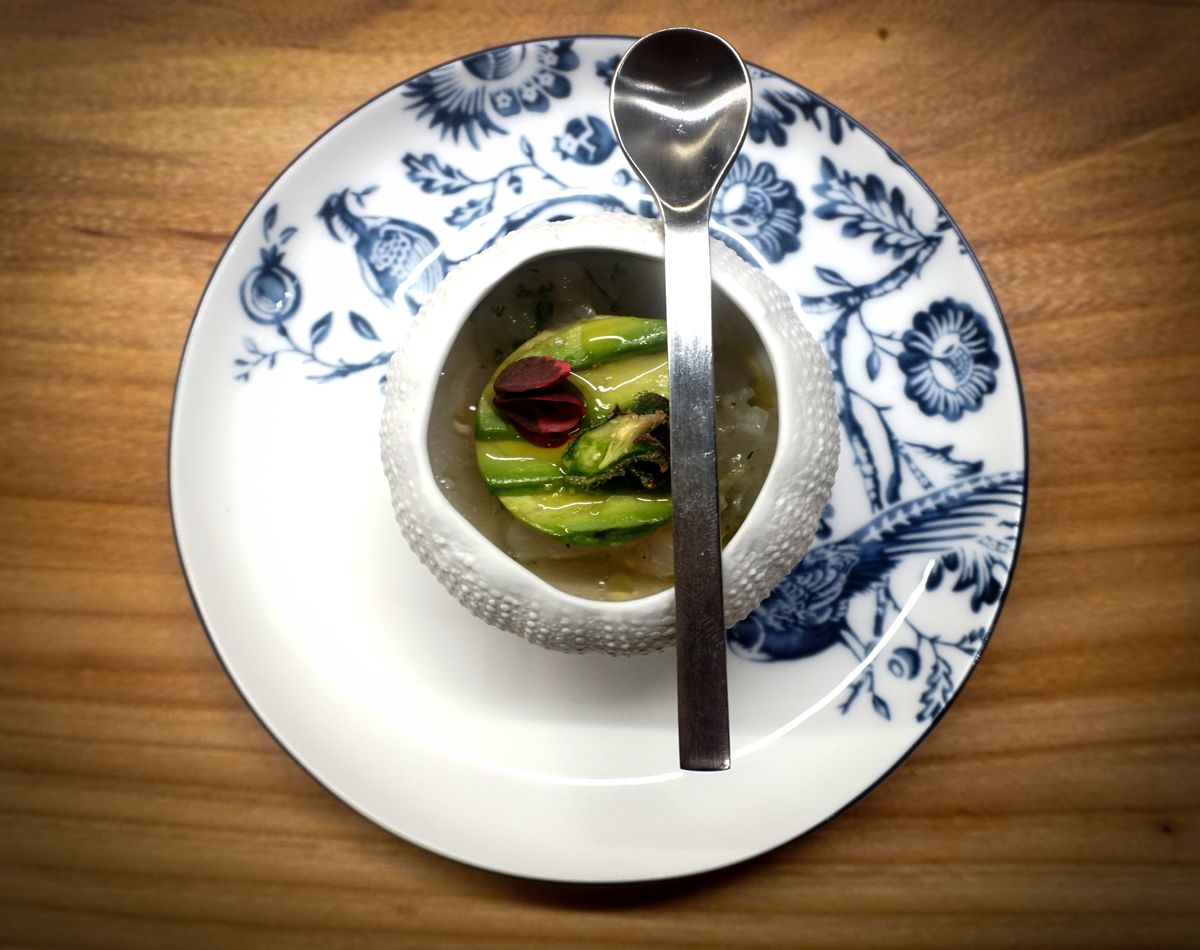 Imperfecto's fluke tartare accented with lemongrass dashi, corn silk, avocado, and edible flowers