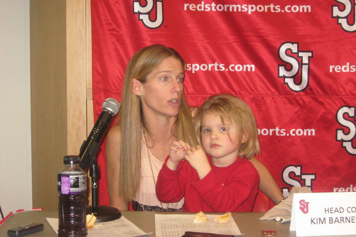 Kim Barnes Arico and daughter Cecelia meet the media.