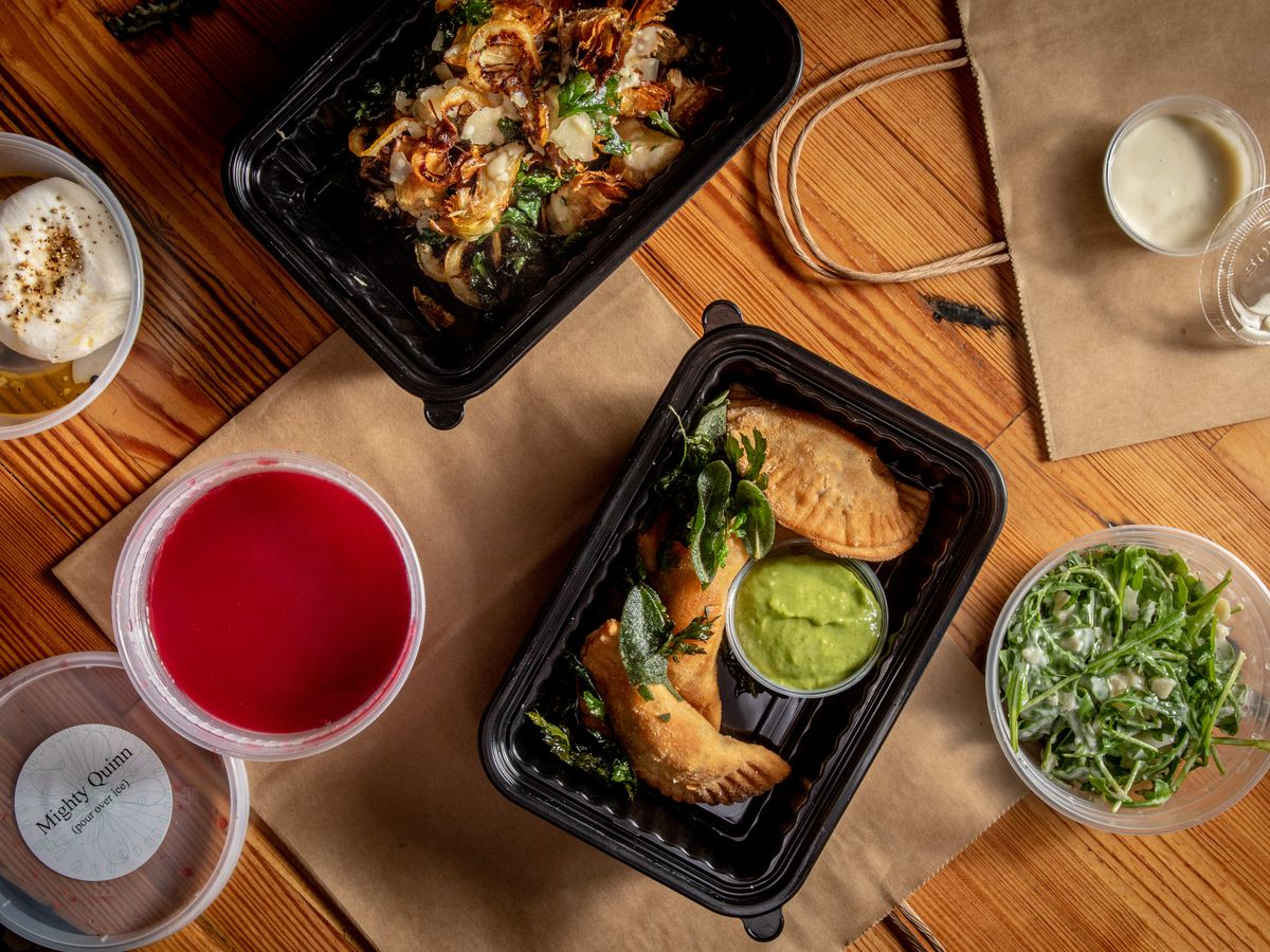 A spread of food in takeout containers at Meadowsweet