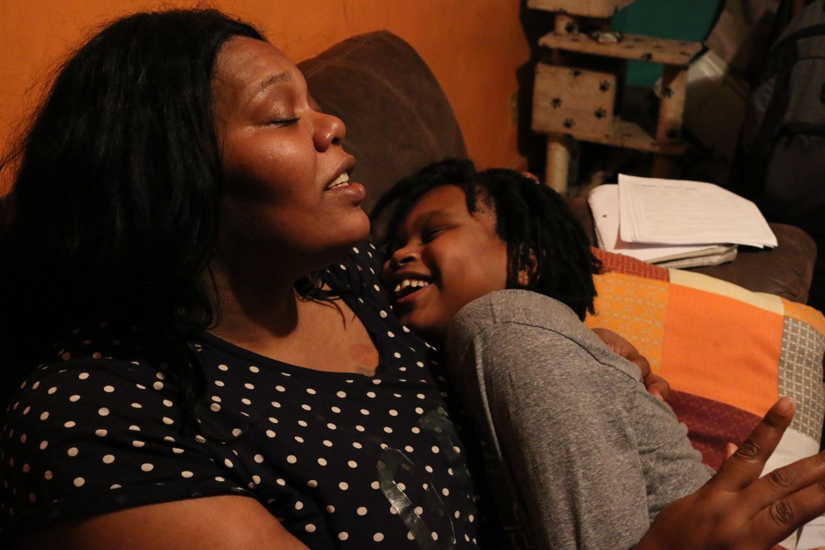 Naisha Jeffries has a meditation session with her son, Bishop. Specialists believe his struggles in school are linked to his exposure to lead as a baby.