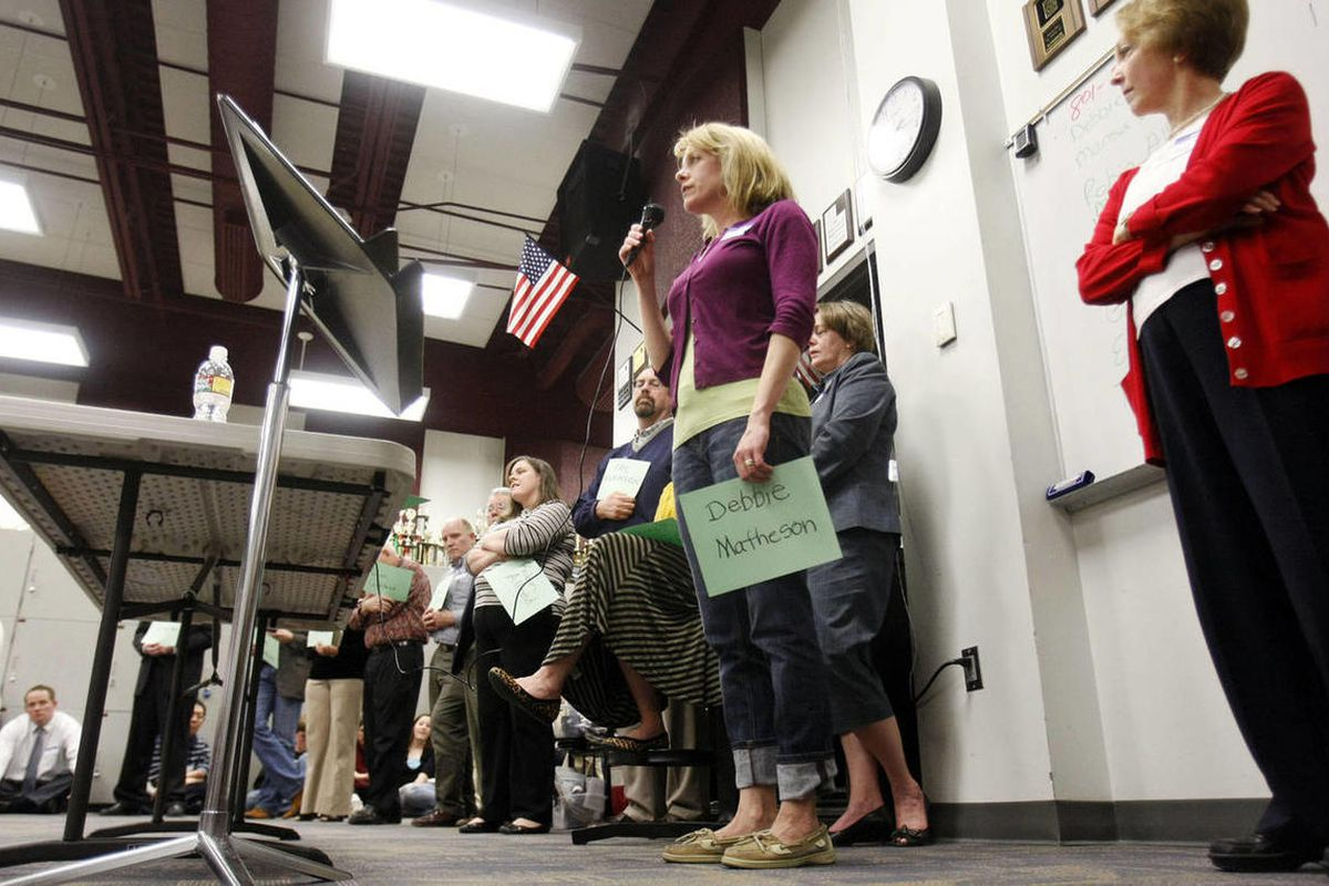 Debbie Matheson, center, introduces herself as a delegate candidate during a GOP caucus meeting at Lone Peak High School in Highland. Thousands turned out at their Republican Party neighborhood caucus meetings around Utah, Thursday, March 15, 2012.