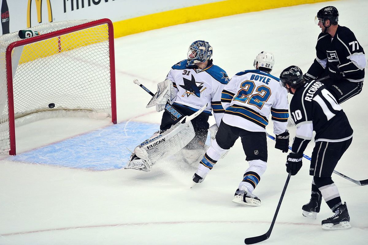 March 20, 2012; Los Angeles, CA, USA; Los Angeles Kings center Mike Richards (10) scores a goal past San Jose Sharks goalie Antti Niemi (31) during the first period at Staples Center. Mandatory Credit: Gary A. Vasquez-US PRESSWIRE