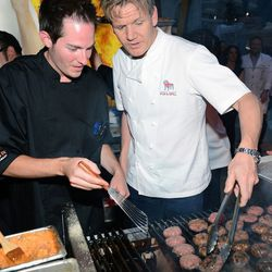 Joe Wilkins and Gordon Ramsay cook at the Gordon Ramsay BurGR booth at the Grand Tasting at Vegas Uncork'd. Photo: Ethan Miller/Getty Images