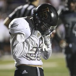 Lone Peak's Britton Berry hangs his head after Corner Canyon scored the game-winning touchdown with two seconds left in the game at Corner Canyon High School in Draper on Friday, Sept. 27, 2019.