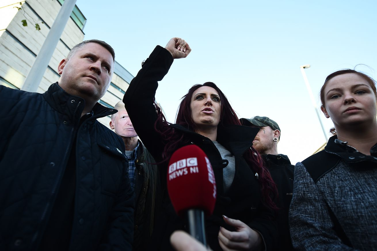 Britain First leader Paul Golding (L) and deputy leader Jayda Fransen (R) talk to media in December 2017.