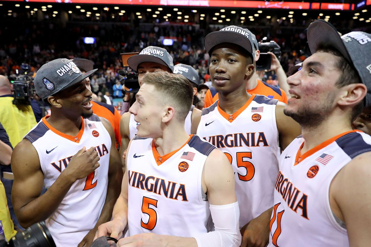 The Virginia Cavaliers celebrate after winning the ACC tournament