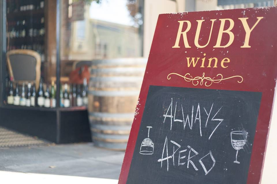 "A sandwichboard sign outside Ruby Wine that reads ""Always Apero"""