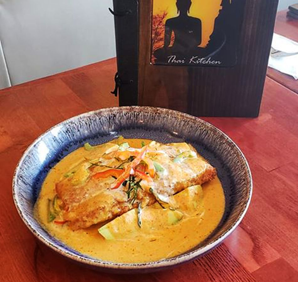 A salmon dish prepared by Boran Thai Kitchen, open six days a week for takeout and delivery.
