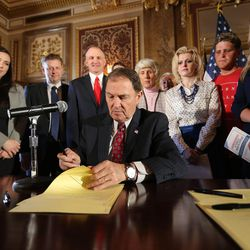 Gov. Gary Herbert signs SCR9, a resolution the state Legislature unanimously passed earlier this year declaring pornography a public health crisis. The signing was held in the Gold Room at the Capitol in Salt Lake City on Tuesday, April 19, 2016.