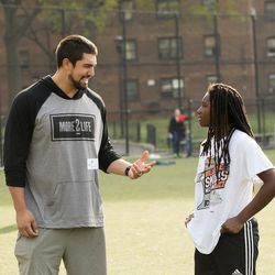 Bronson Kaufusi instructs kids at a youth football clinic staged in New York City last weekend.