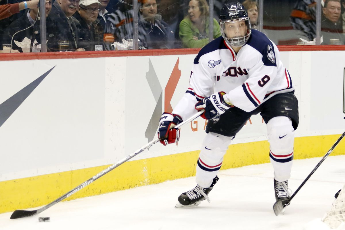 UConn's Alexander Payusov (9) during the Northeastern Huskies vs UConn Huskies men's college ice hockey game game at the XL Center in Hartford, CT  on November 28, 2017.