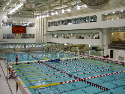 A large indoor pool with lanes.